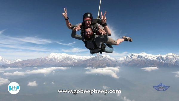 guy skydiving over the Himalayas